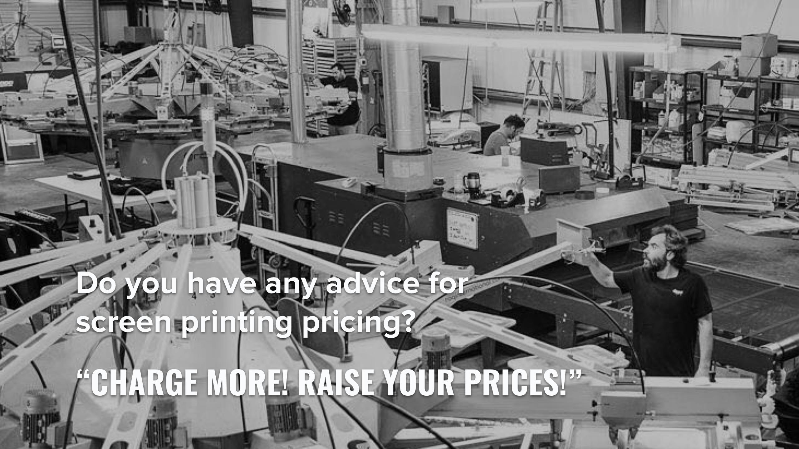 A screen printer operates a large ROQ automatic screen printing press.
