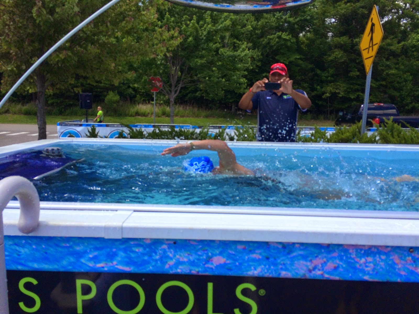 a triathlete swims freestyle in the Performance Endless Pool at the Rev3 Triathlon in Williamsburg, Virginia