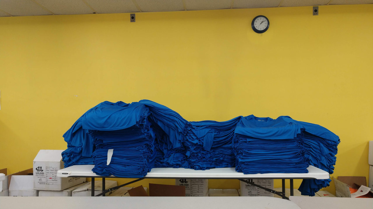 Several hundred t-shirts prepared for screen printing.