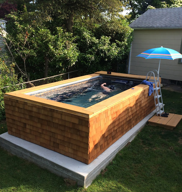 an outdoor, cedar-skirted Endless Pools swimming machine
