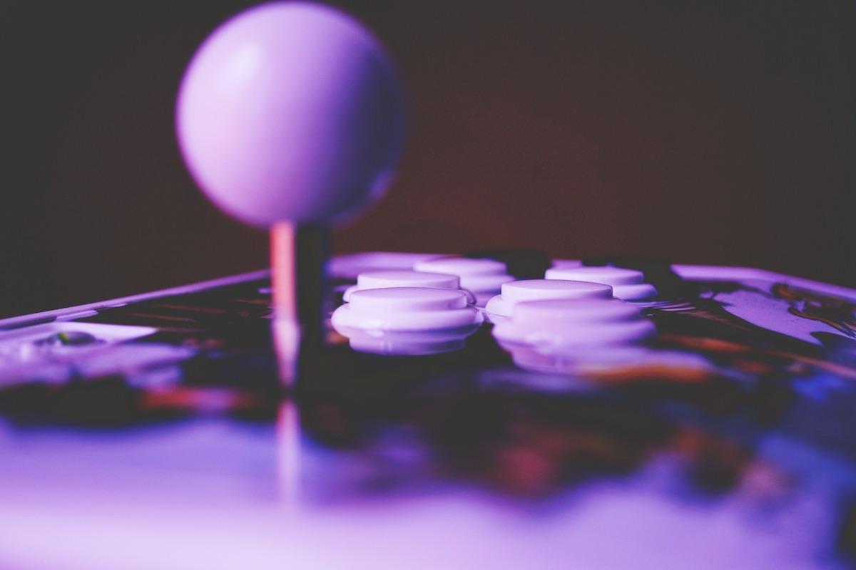 Closeup of a joystick control for an arcade game