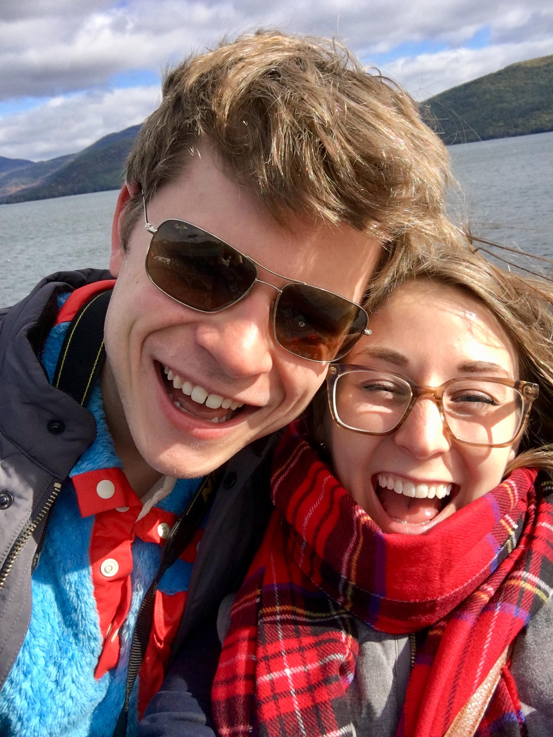 selfie photo of couple on lake