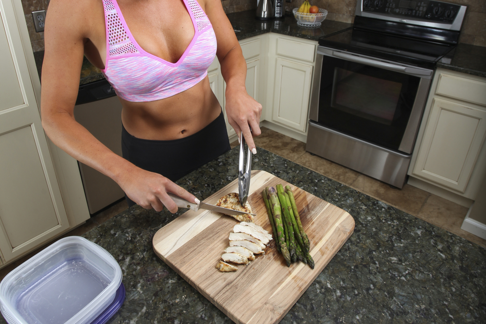 Woman prepping veggies for meal