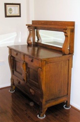 beveled-mirror-on-antique-buffet.png