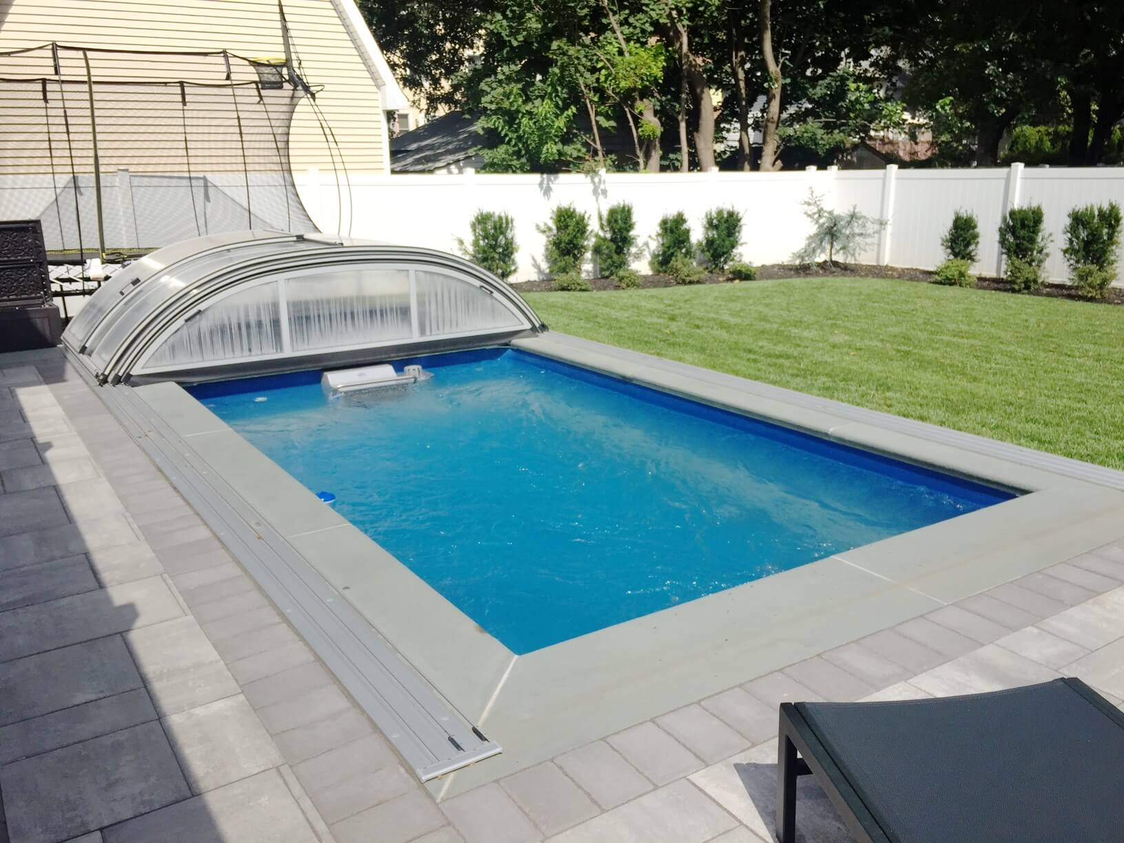 a fully in-ground Endless Pool enclosure, retracted