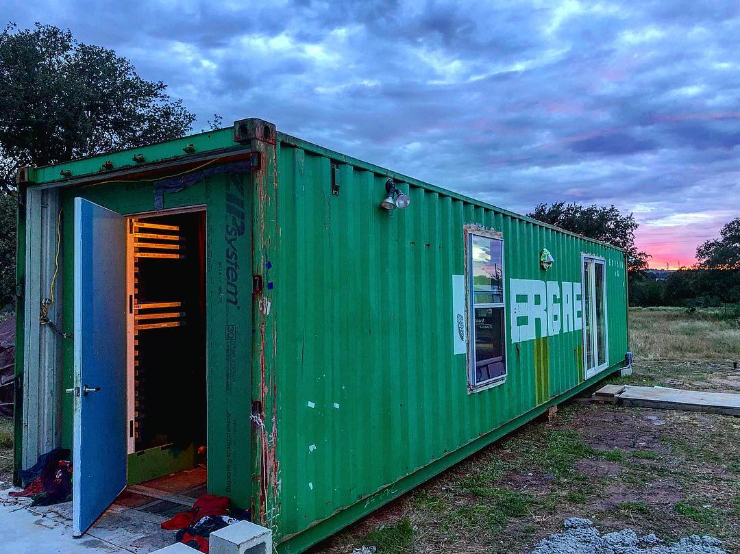 A shipping container converted into a print shop.