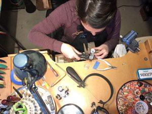 Julia Mancarella working at her jewelry bench