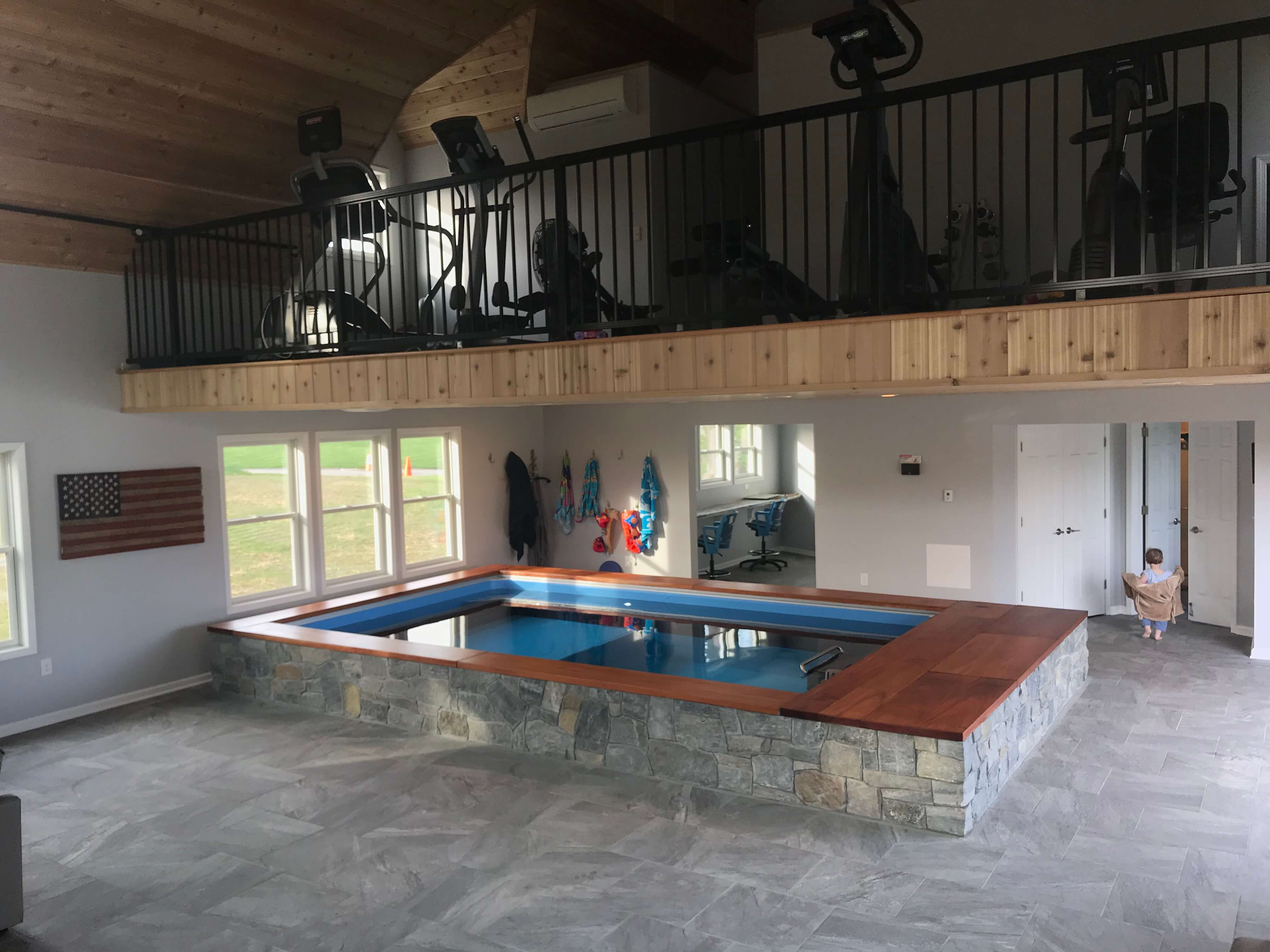 a pain cave outside Pittsburgh with an Endless Pool and a mezzanine