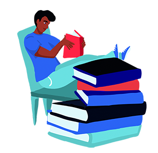 Man sitting in a chair reading behind a stack of books.