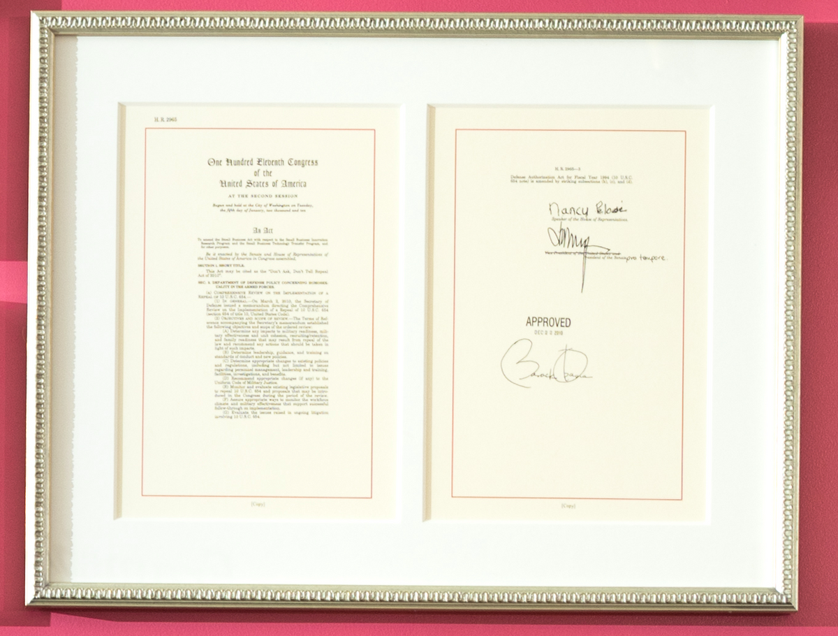 signed law document in silver frame with thick mat
