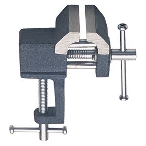 Small metal vise for jewelry bench
