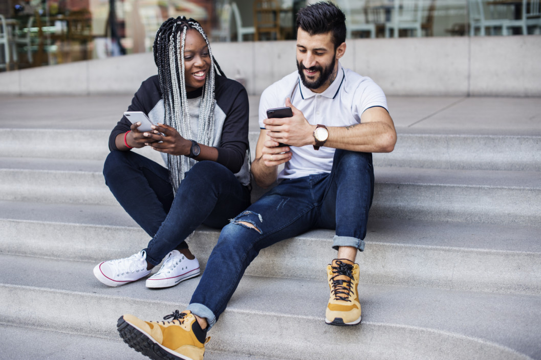 guy and girl looking at their phones