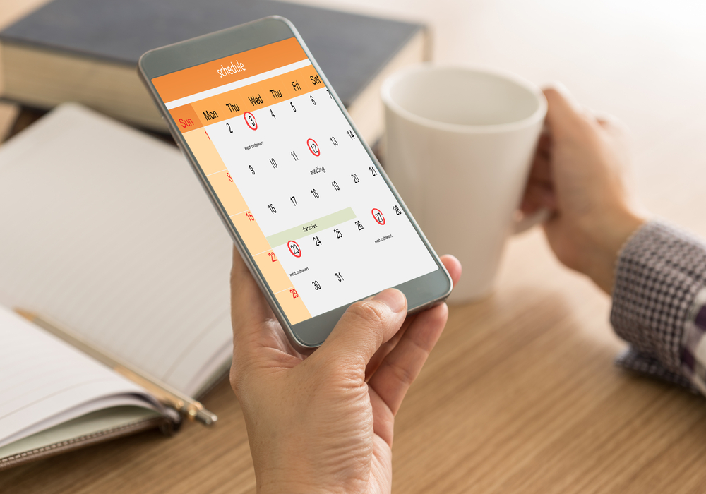 monthly scheduled reminders on women's phone