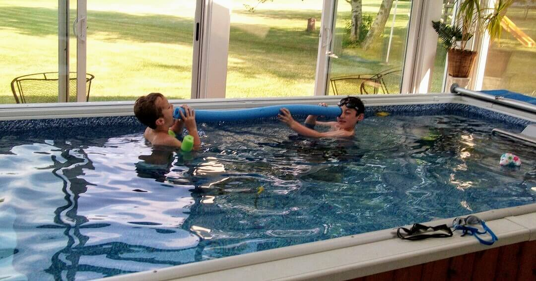 Gayle's grandkids play in her Original Endless Pool when she's not using it for aquatic therapy for her multiple sclerosis