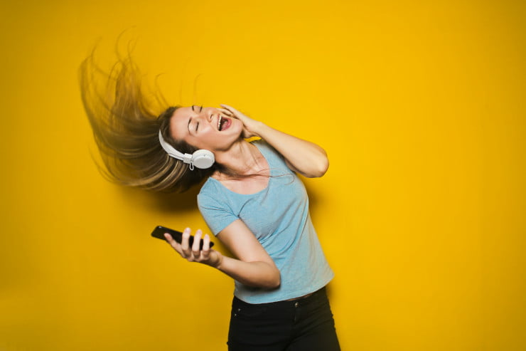woman listening to music on Spotify