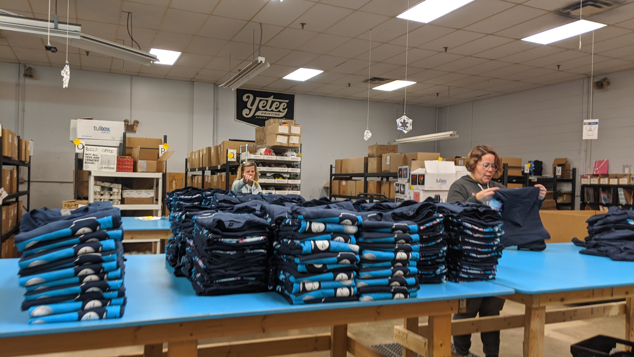 Folding t-shirts at The Yetee is a big task.