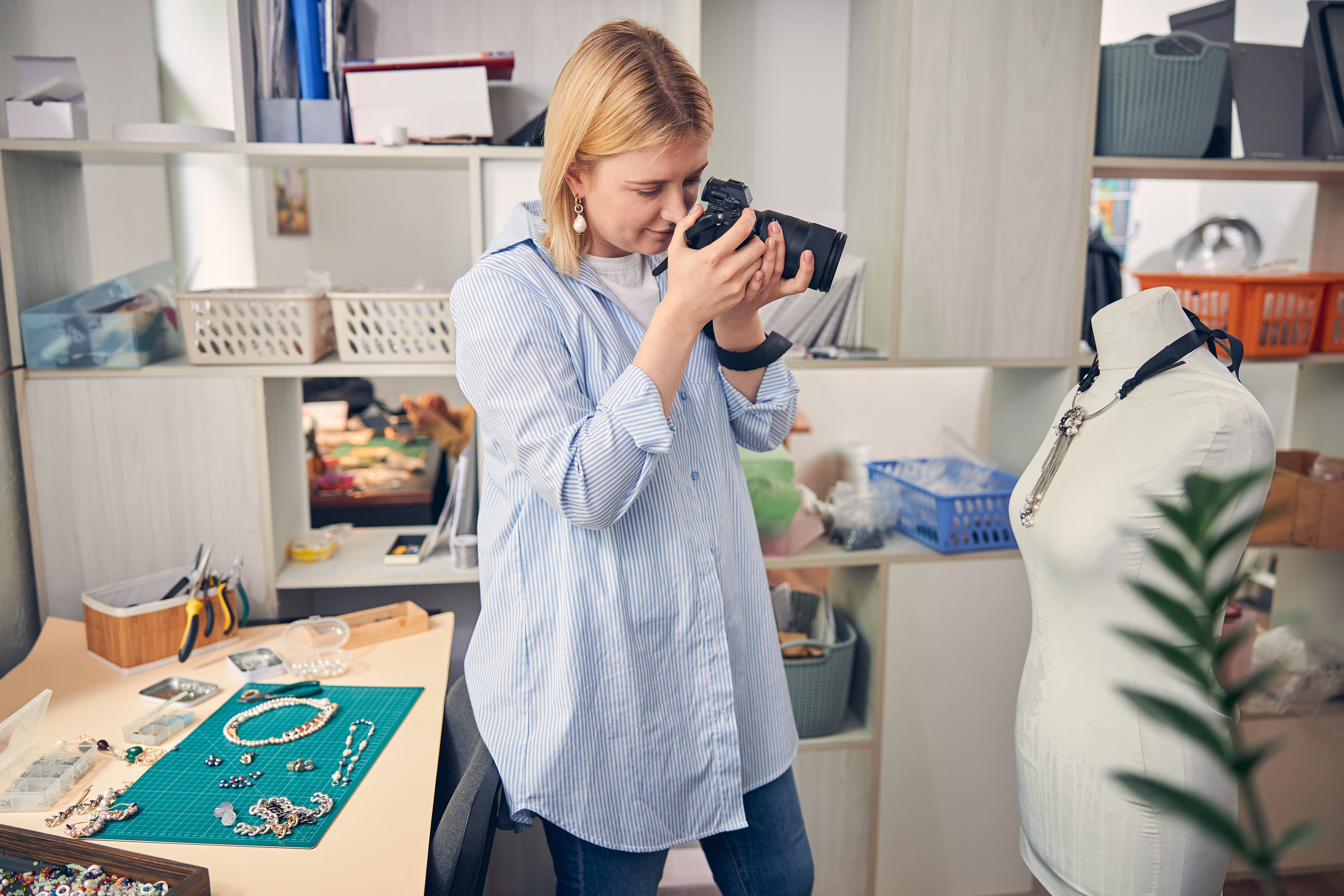 Woman photographing jewelry