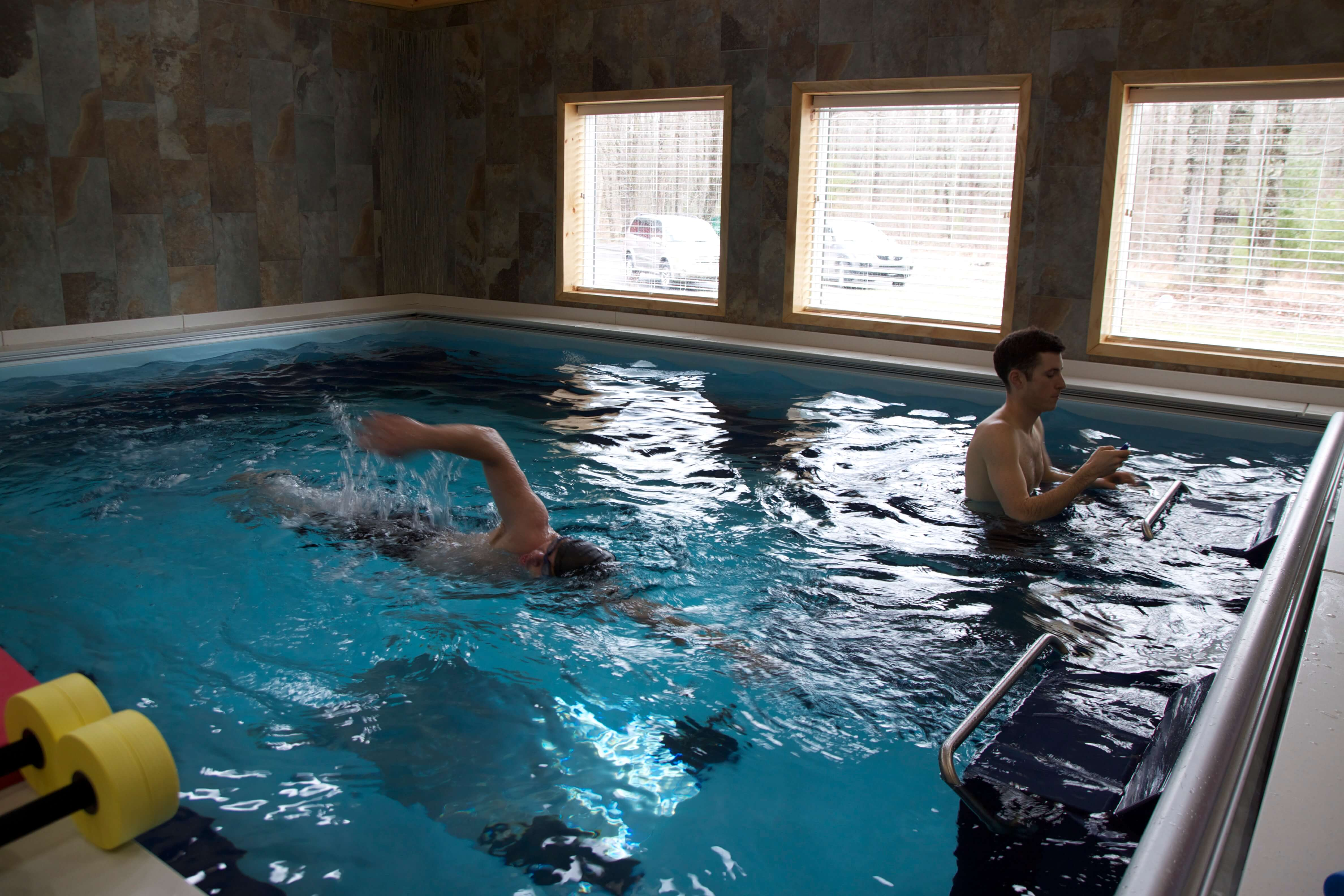 Two clients in the Dual Propulsion Endless Pool at Pike Physical Therapy