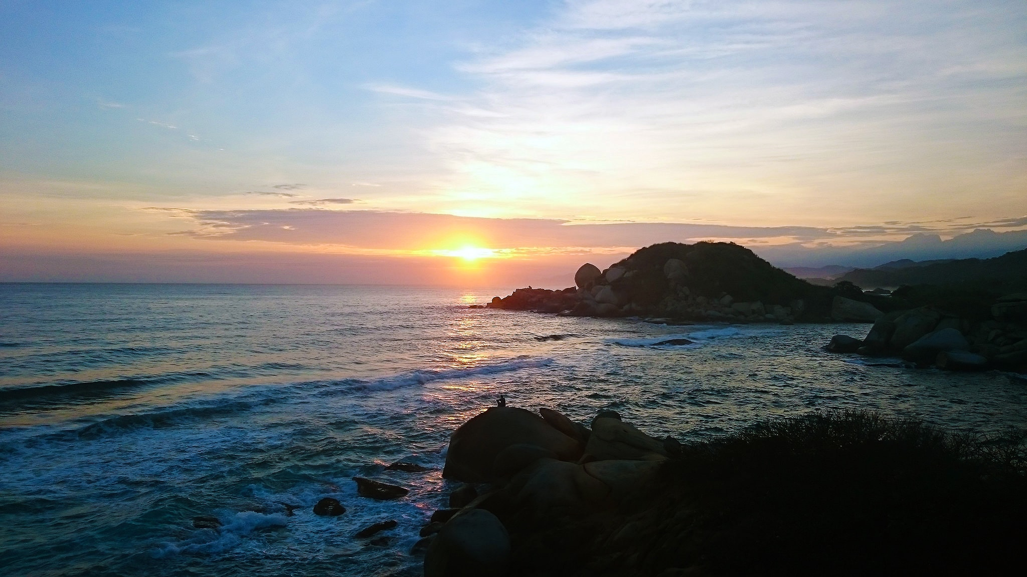 Tayrona Colombia colorful sunrise on the beach
