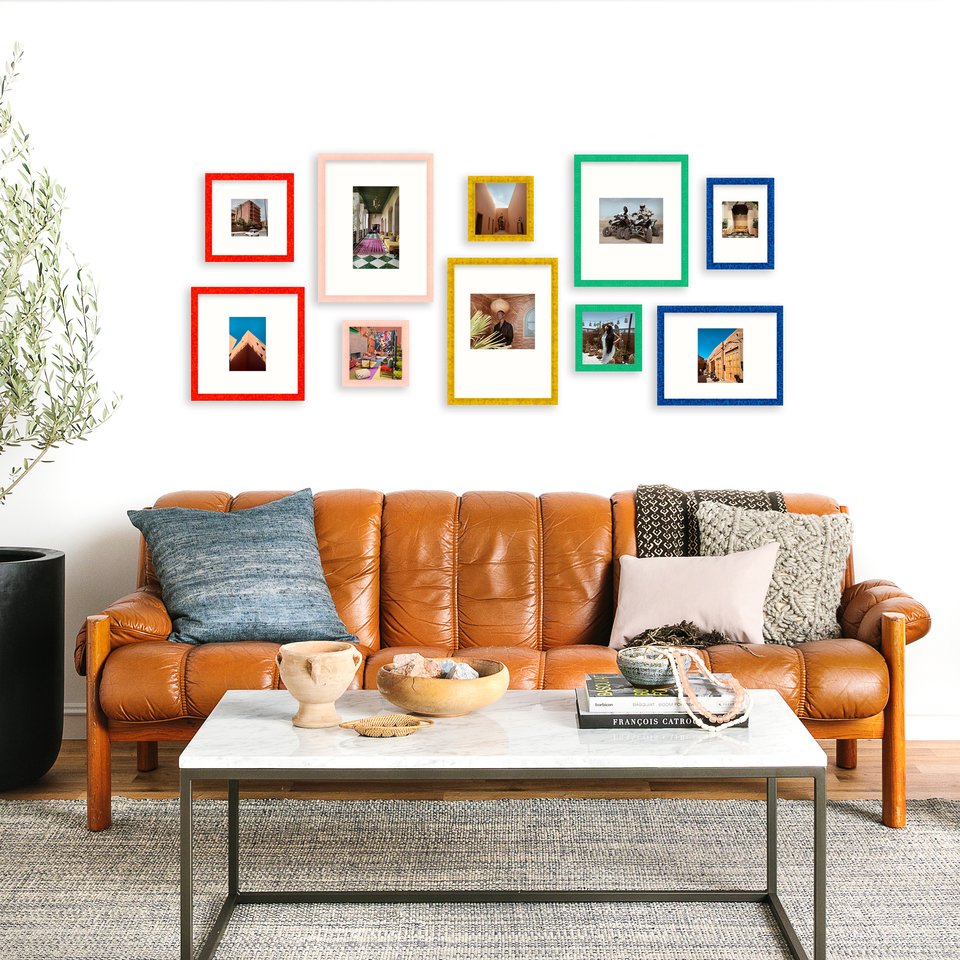 wide organic gallery wall in colorful frames