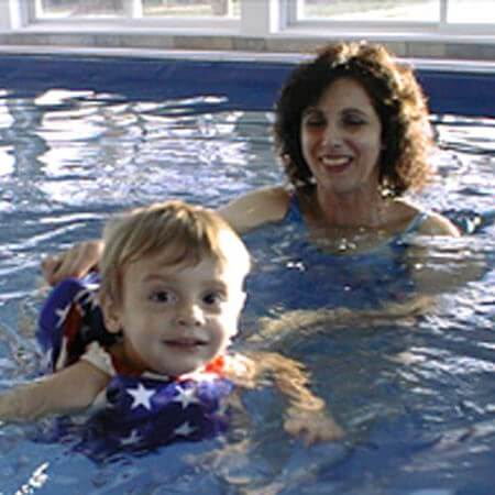 Valarie Arms and her son in their indoor Endless Pool