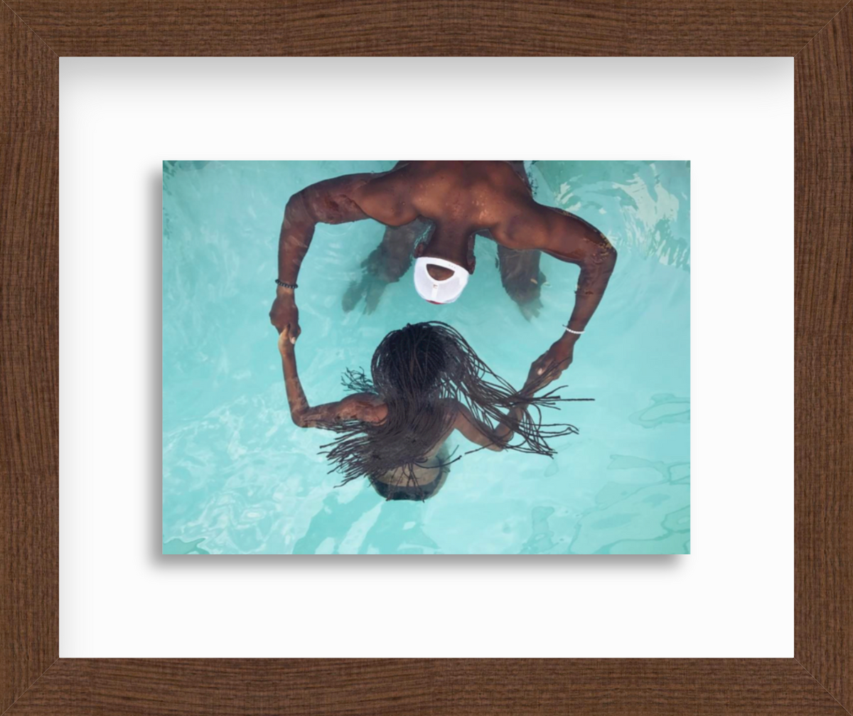 Photo of girl and man in swimming pool