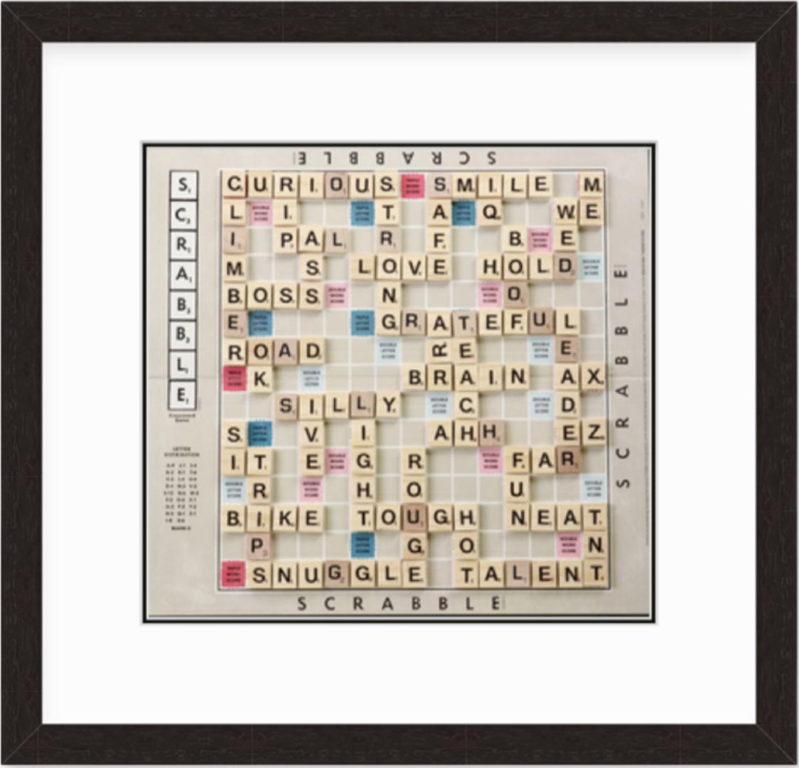 framed Scrabble game board in black walnut frame