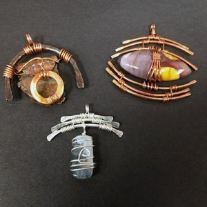 Wire wrapped pendants using multiple gauges for frames