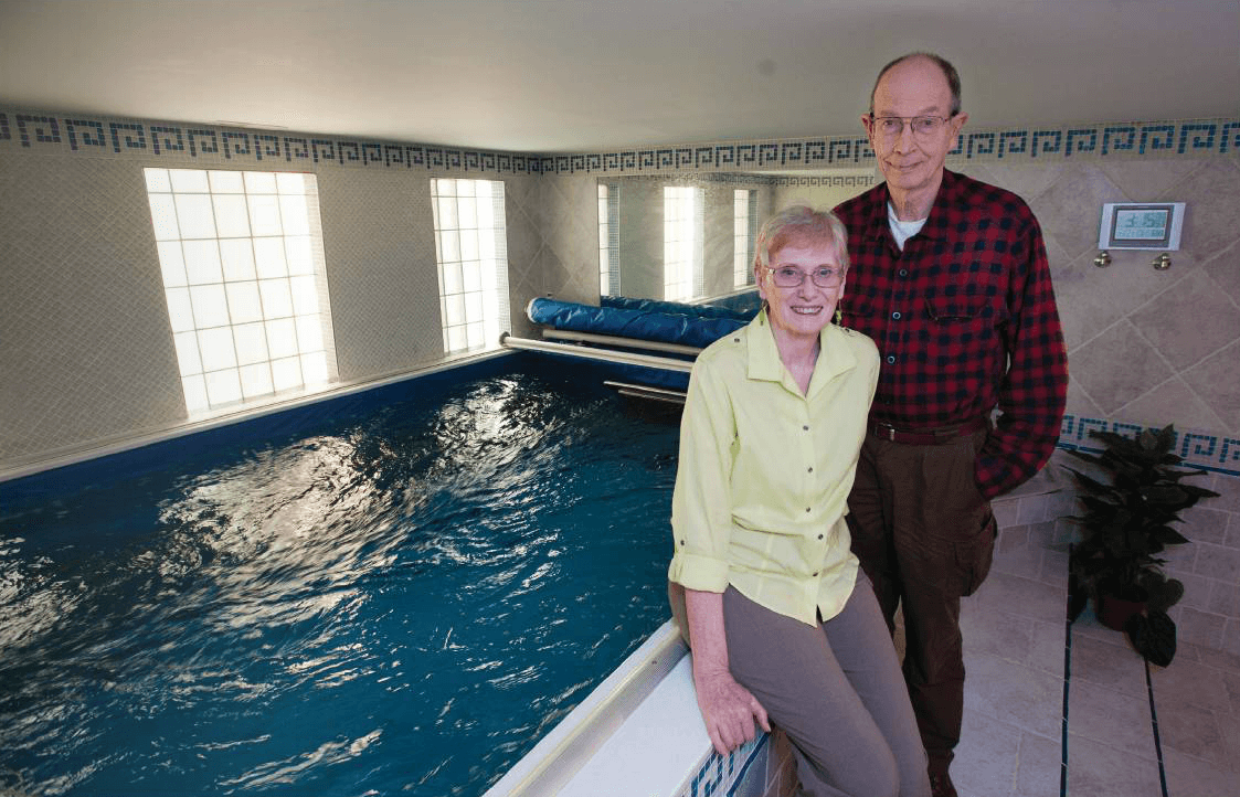 The Goetzes at home with their Endless Pools swimming machine