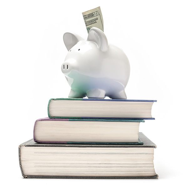 A photo of a piggy bank sitting on a stack of textbooks