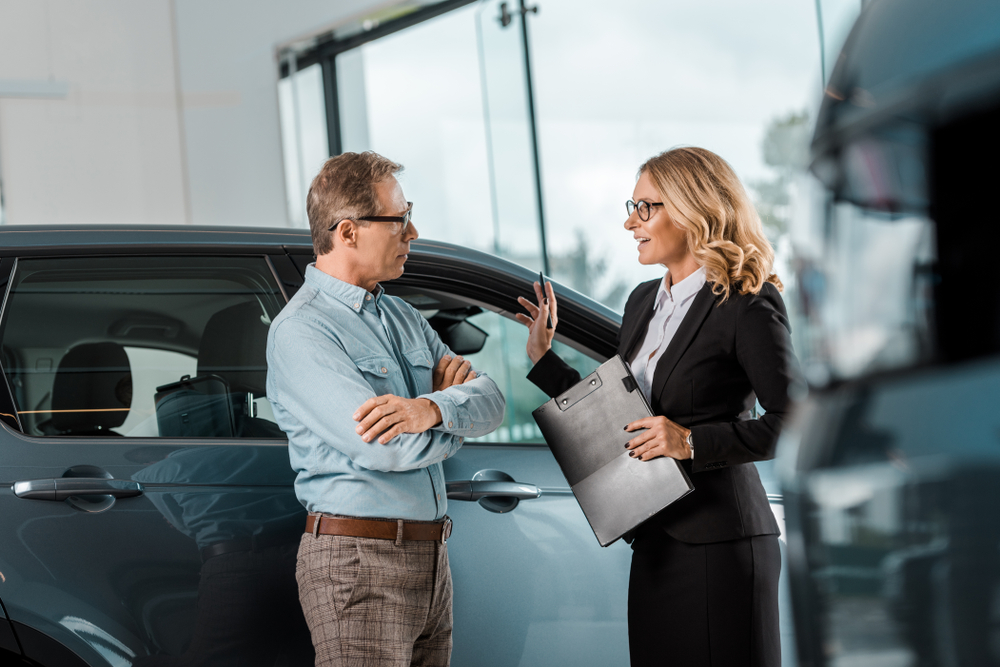 car salesperson talking to a buyer