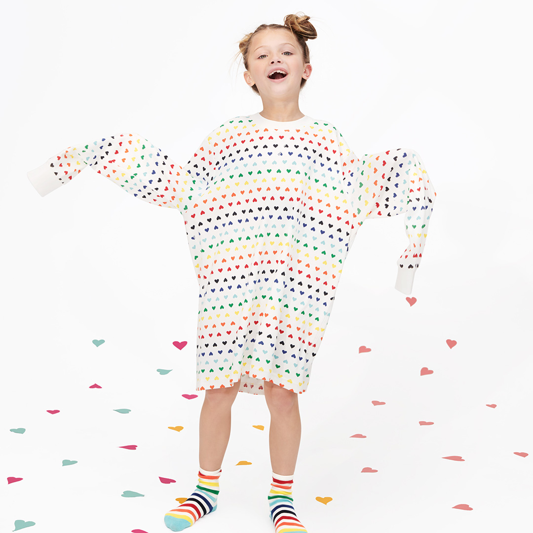 child wearing rainbow heart adult pajama top