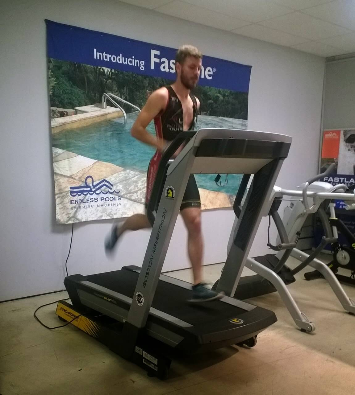 a triathlete on a treadmill at the Endless Pools Factory Showroom