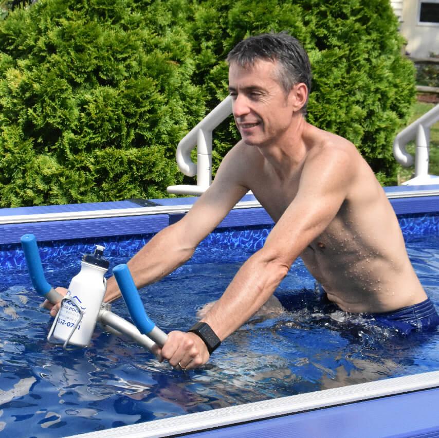 91cfa421f9 man using the Aqua Bike in an Original Endless Pool.