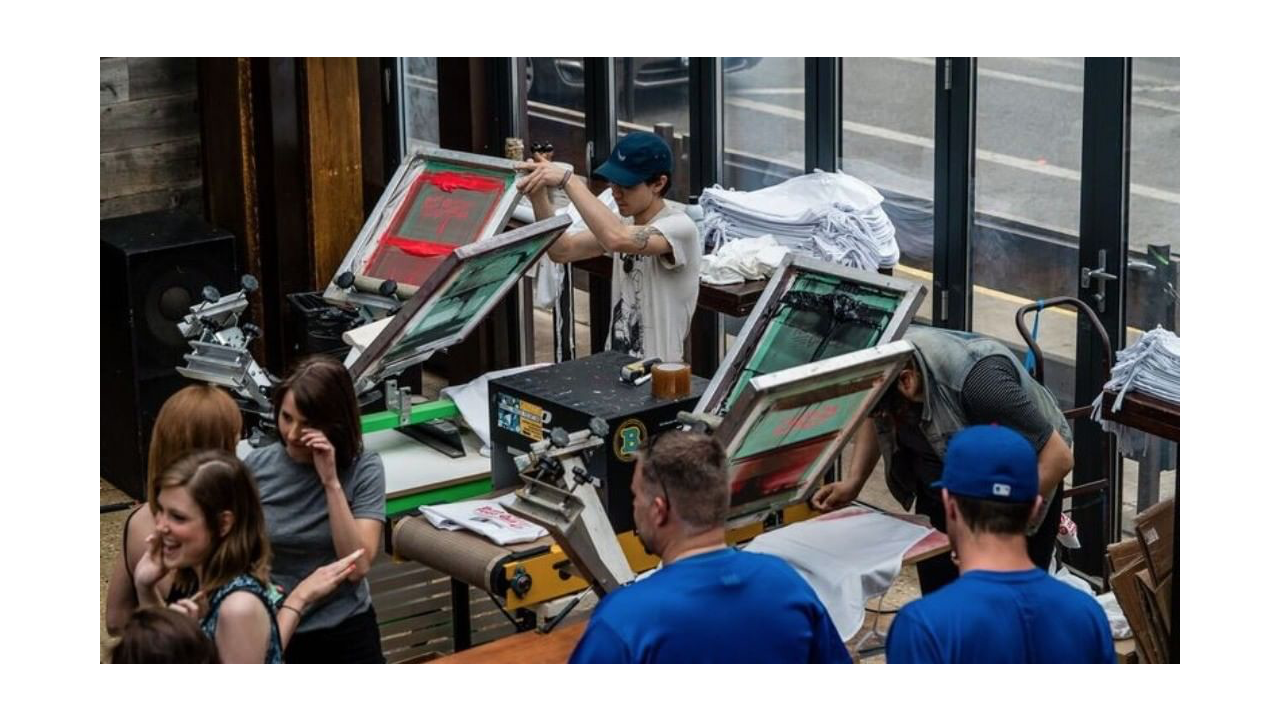 Putting on a show at a live screen printing event.