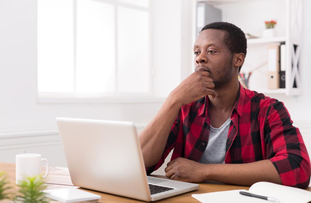 serious man on laptop
