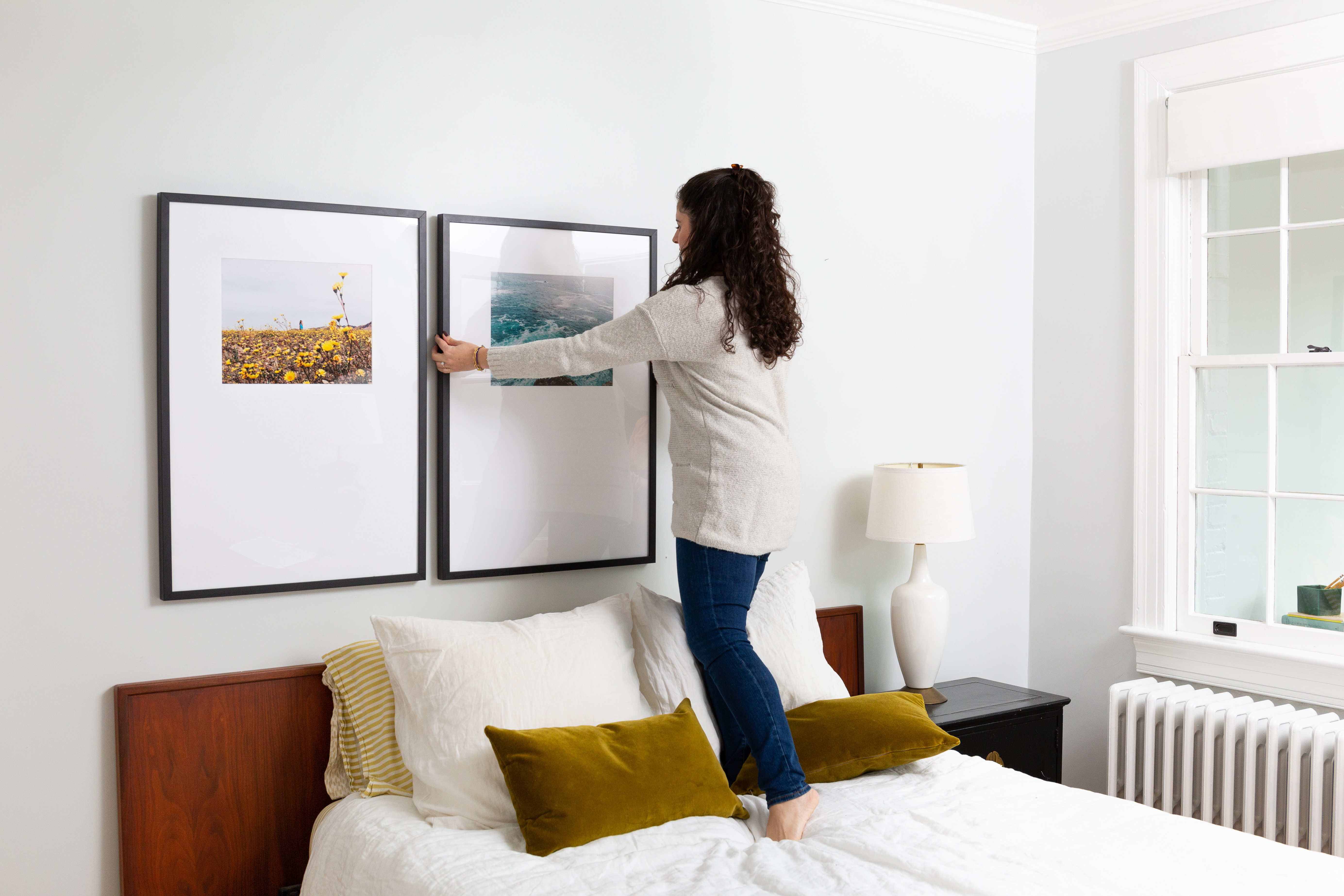 woman hanging triptych gallery wall