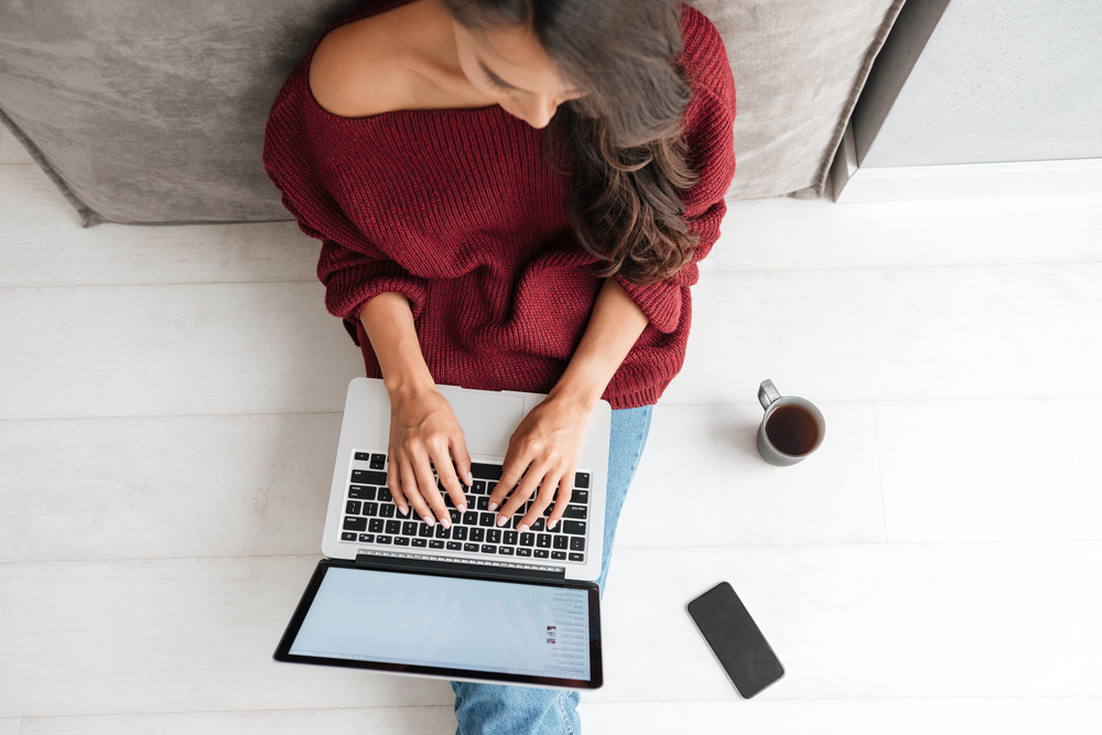 woman on laptop with cup of coffee