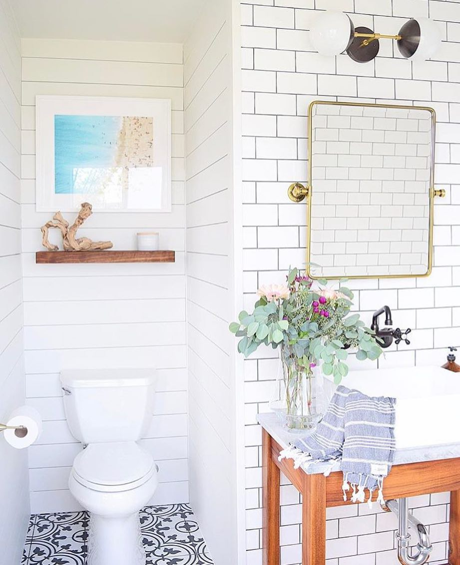 eucalyptus styled in while tile bathroom