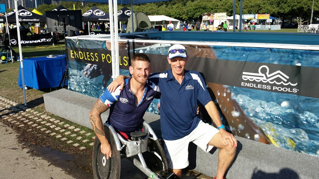 Paratriathlete Joe Townsend at the Endless Pools booth at the ITU World Triathlon Grand Final Chicago Expo