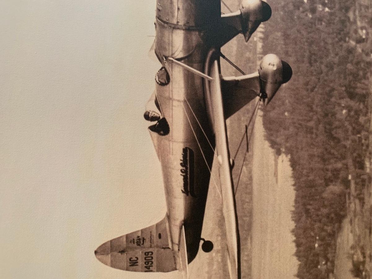 Man flying old timey plane
