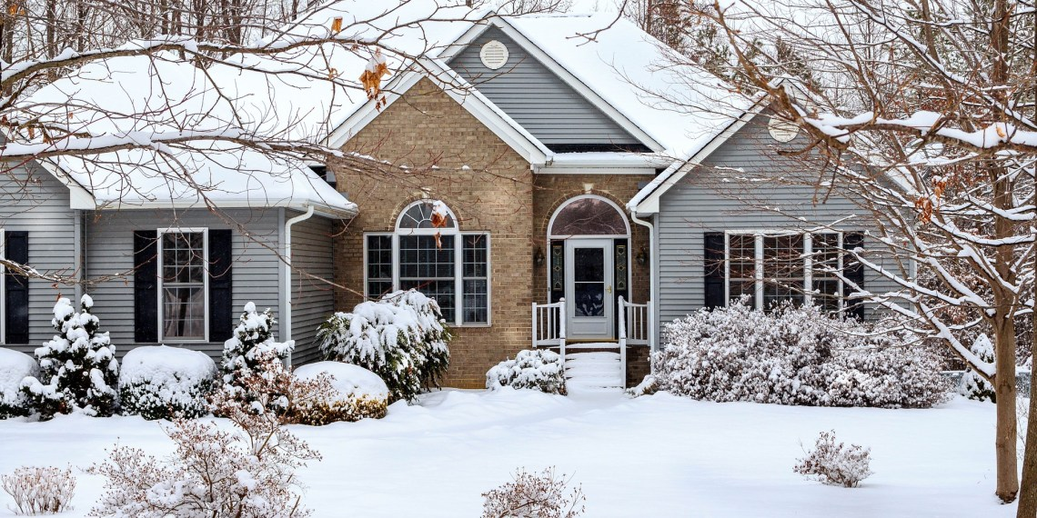bungalow with snow covered front yard