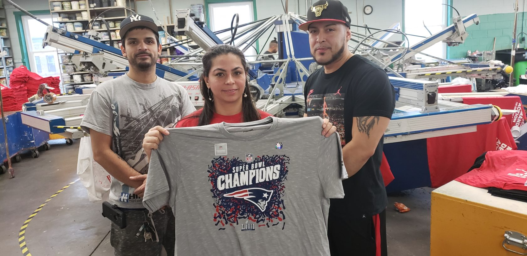 Screen printing shirts for the New England Patriot's Super Bowl victory