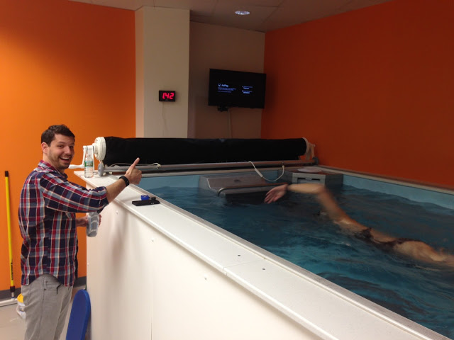 Coach Dominic Latella gives thumbs-up at the Endless Pool at his SwimBox studio