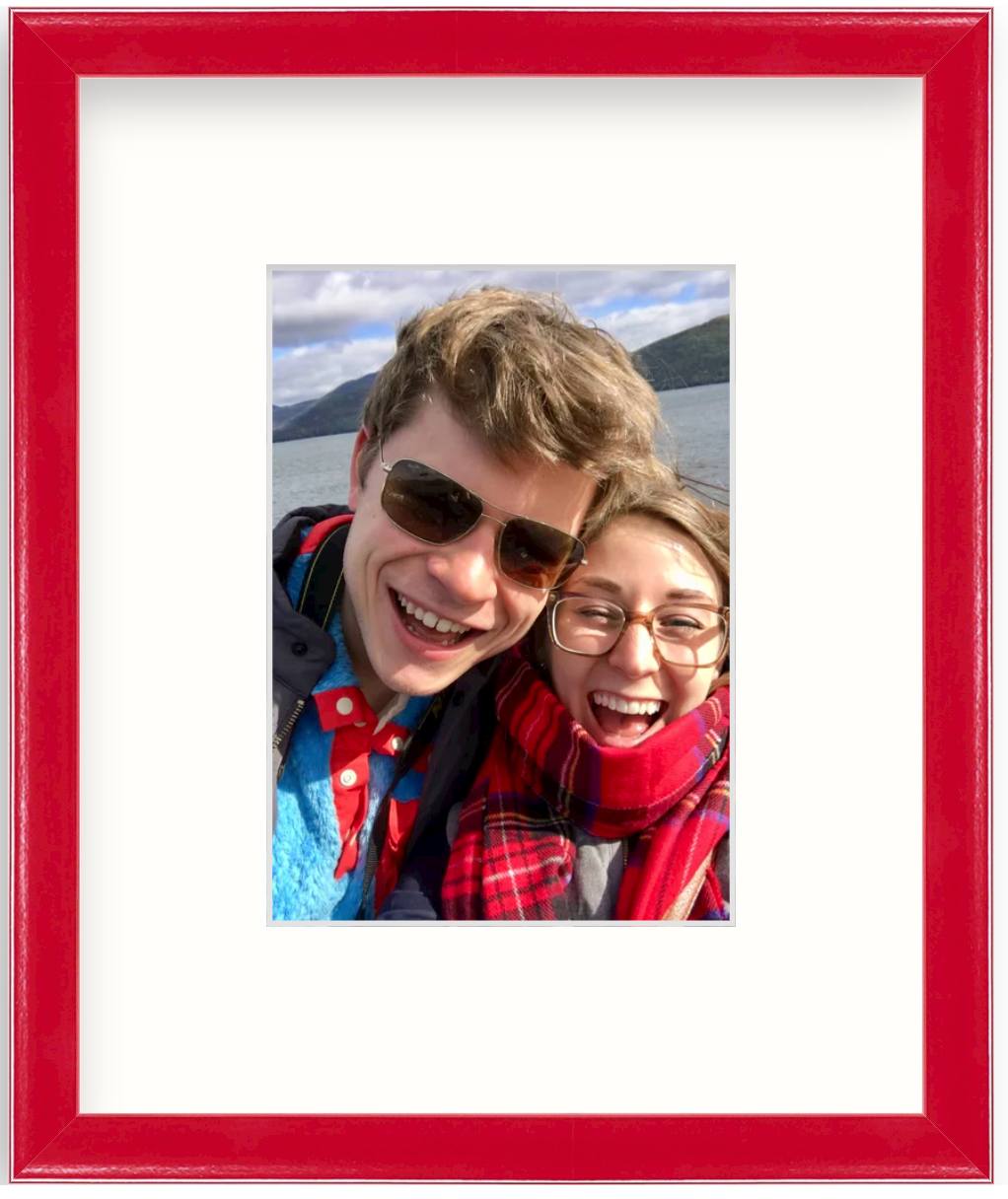 selfie photo of couple on lake in red frame