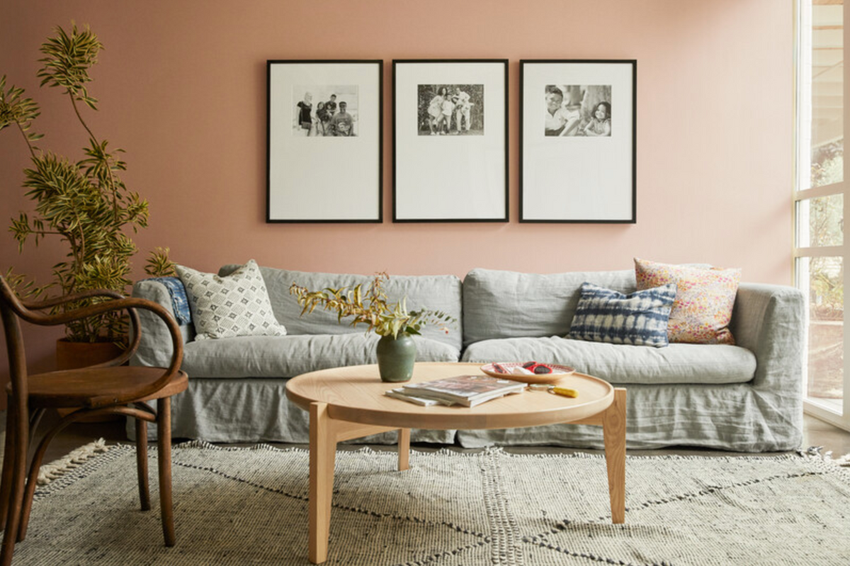 Triptych gallery wall in living room over couch
