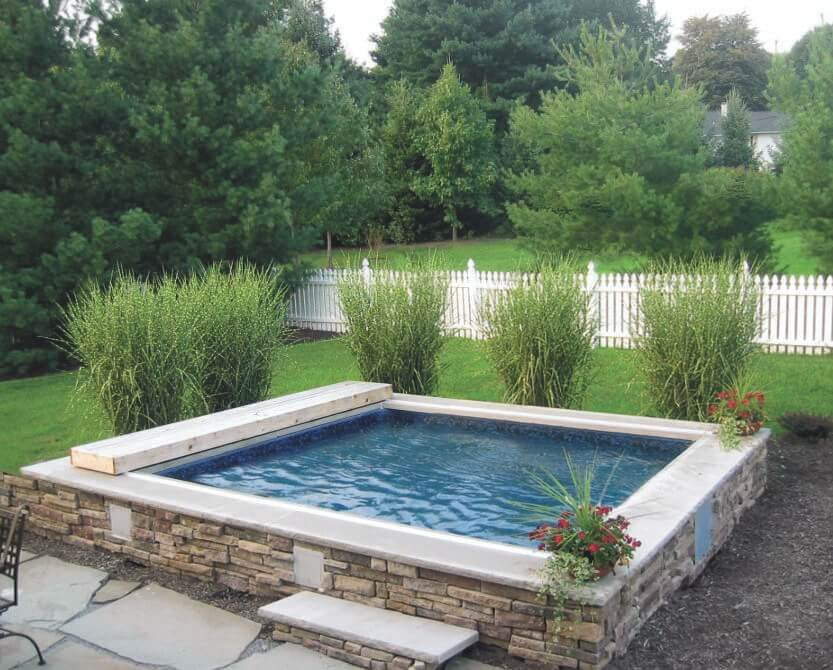 A Partially In Ground Endless Pool Waterwell Serves As The Garden Plunge