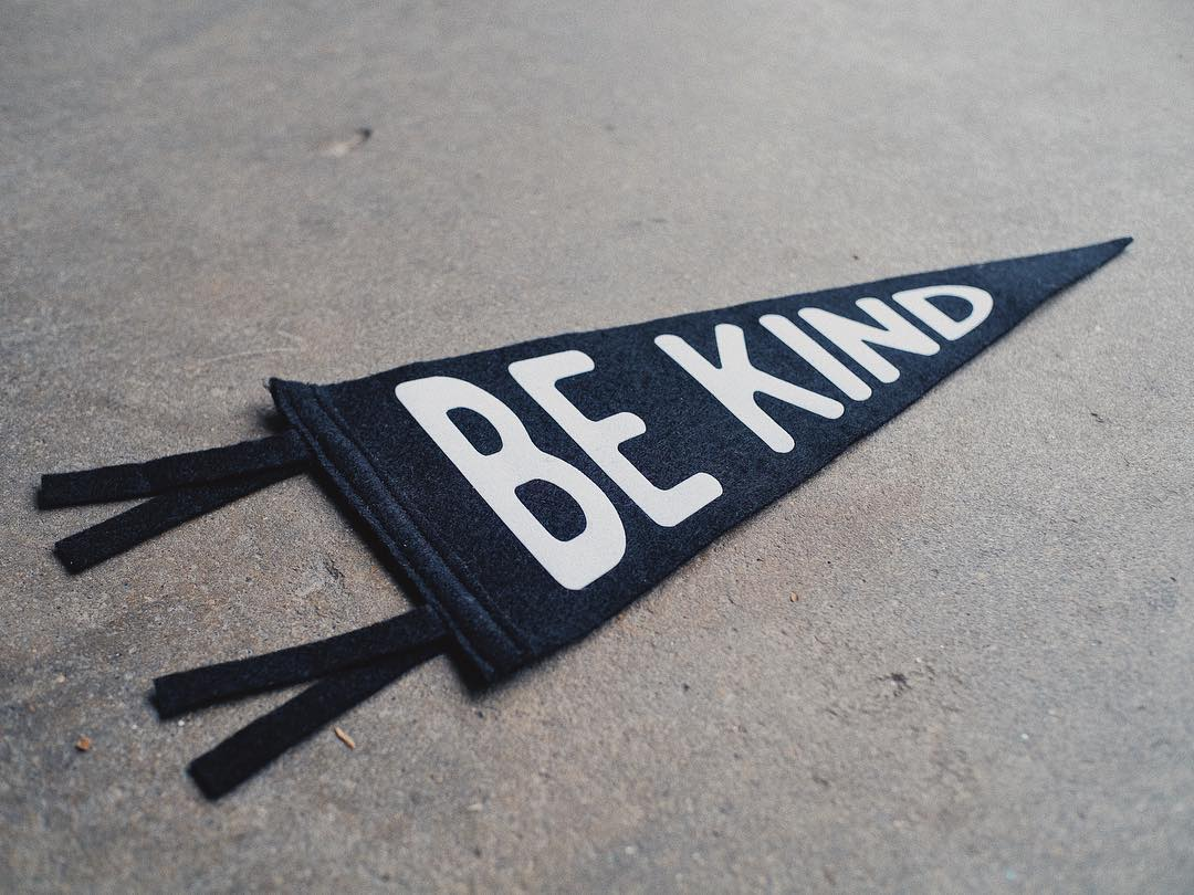 @divisionandco pennants with a good reminder to be kind.