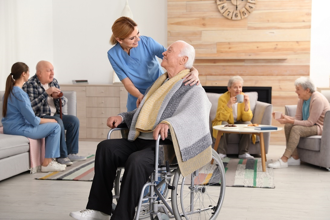 elderly-man-and-nurse-in-long-term-care-facility-nursing-home-assisted living