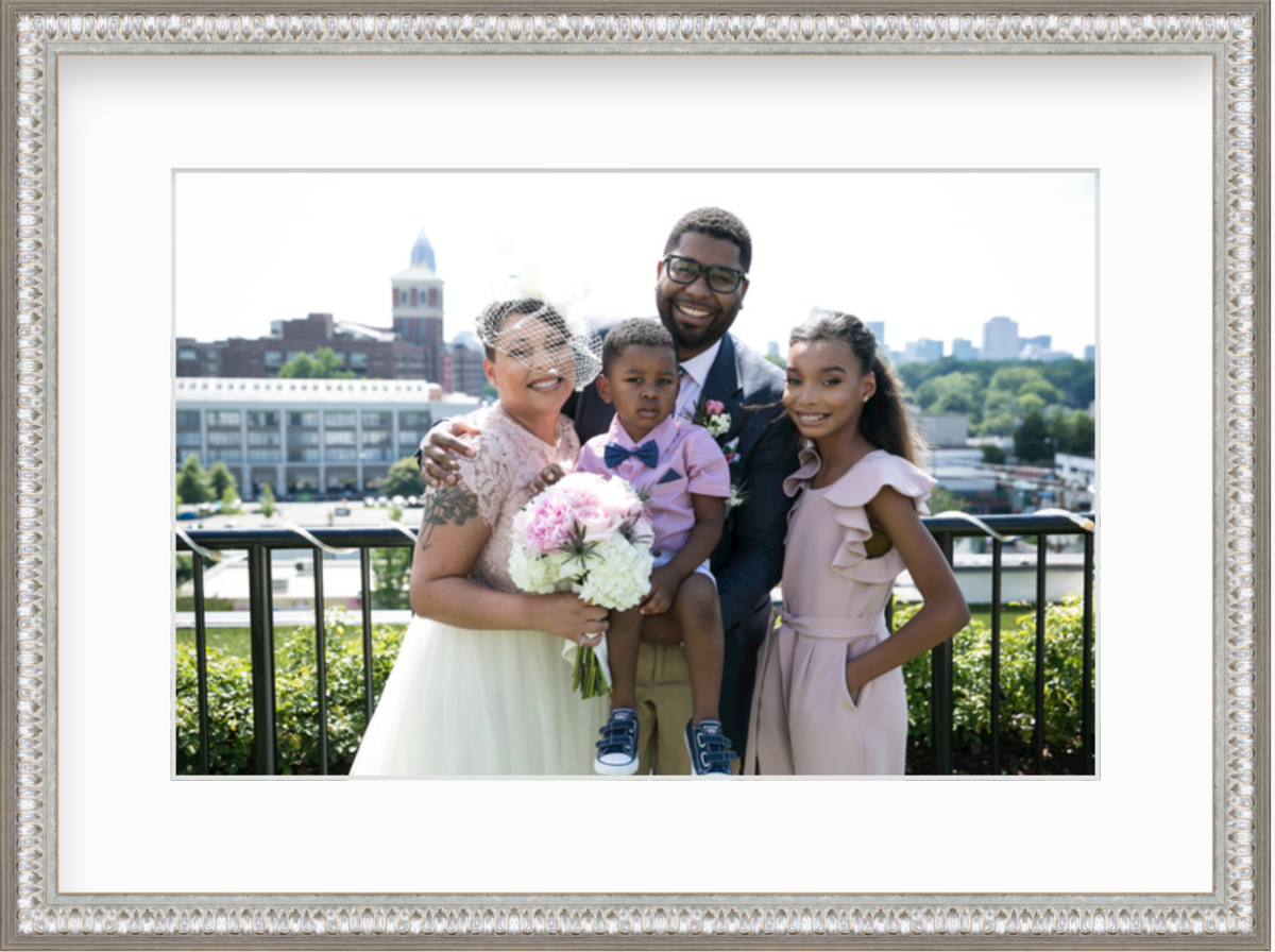 Wedding photo of man and woman with two children in silver frame